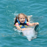 Happy Young Girl Belly Ride Dolphin Mexico